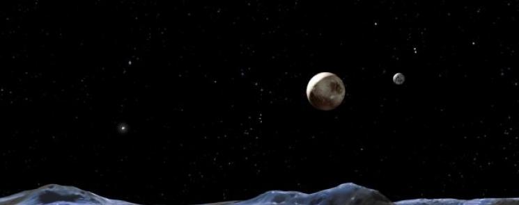 Так в представлении художника выглядят Плутон и его спутники. Плутон в центре. Харон меньший диск справа